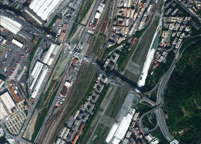 Satellite image at 30 cm resolution showing the full extent of the collapsed section of Morandi Bridge and surrounding disaster relief efforts in Genoa, Italy. 📷 15/8/2018 by WorldView-4 © European Space Imaging
